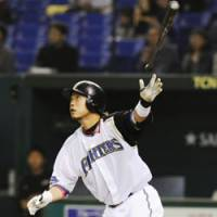 Hit parade: Eiichi Koyano and the Hokkaido Nippon Ham Fighters are off to a torrid start at the plate so far this season. | KYODO PHOTO