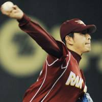 Sensational outing: Eagles hurler Hisashi Iwakuma, who retired 21 straight batters in one stretch of Saturday's game against the Buffaloes, tosses eight innings of scoreless ball at Tokyo Dome. Tohoku Rakuten beat Orix 7-0. | KYODO PHOTO