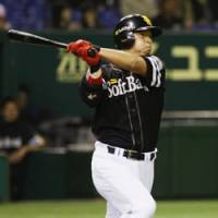 Repeat feat: Softbank Hawks slugger Nobuhiko Matsunaka hits a two-run homer for the second consecutive at-bat in the fourth inning against the Nippon Ham Fighters on Tuesday at Tokyo Dome. | KYODO PHOTO