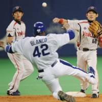 Rapid fire: Yakult's Ryosuke Morioka throws to first to complete a 6-4-3 double play in the Swallows' 3-0 win over the Dragons on Thursday.   KYODO PHOTO