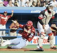 Safe: Rakuten's Tatsuya Shiokawa slides home during the Golden Eagles' 6-2 win over the Marines on Saturday. | KYODO PHOTO