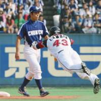 Brave dive: The Marines' Chase Lambin makes a head-first slide into second base before Shoitsu Omatsu's game-winning hit against the Dragons on Saturday.   KYODO PHOTO