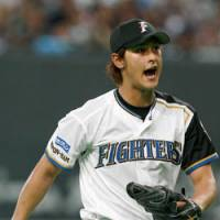 On-the-job satisfaction: Fighters ace Yu Darvish shows his competitive spirit in Saturday's game against the Dragons. Darvish allowed five hits in eight innings and helped Hokkaido Nippon Ham beat Chunichi 9-1. | KYODO PHOTO