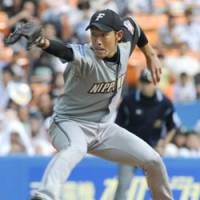 Streak continues: Fighters starting pitcher Tomoya Yagi tosses a pitch against the Marines on Saturday. The lefty improved to 6-0 on the season in Hokkaido Nippon Ham's 5-4 win. | KYODO PHOTO