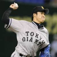 Turning back the clock: Yomiuri starter Shun Tono, shown in the Giants' throwback uniform, throws a pitch against the Yokohama BayStars during their game on Tuesday at Tokyo Dome. | KYODO PHOTO