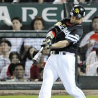 Back-to-back shots: Softbank Hawks slugger Nobuhiko Matsunaka hits a home run for the second straight at-bat in the sixth inning during the second game of the NPB All-Star Series at Mazda Stadium in Hiroshima on Saturday. The Pacific League beat the Central League 7-4.   KYODO PHOTO