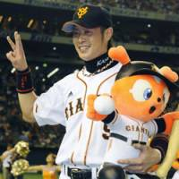 Hero of the day: Giants outfielder Yoshiyuki Kamei enjoys the spotlight after his 10th-inning 'sayonara' home run gives his team a 2-1 victory over the Tokyo Yakult Swallows on Saturday afternoon. | KYODO PHOTO