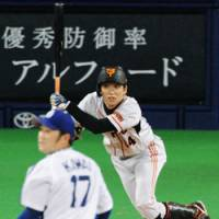 Youngster's big night: Giants outfielder Tetsuya Matsumoto hits an RBI double off Dragons starter Yudai Kawai in the fifth inning at Nagoya Dome on Wednesday. Matsumoto went 3-for-5 in Yomiuri's 7-4 win. | KYODO PHOTO