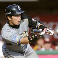 Solid play: Fighters catcher Shinya Tsuruoka makes a squeeze bunt with one out and the bases loaded in the fifth inning against the Eagles in Sendai on Saturday. Hokkaido Nippon Ham crushed Tohoku Rakuten 10-3. | KYODO PHOTO