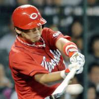 Blasting it: Carp infielder Tetsuya Kokubo hits a double to give his team a 1-0 lead in the second inning against Hanshin at Koshien Stadium on Friday. Hiroshima edged the Tigers 5-4. | KYODO PHOTO