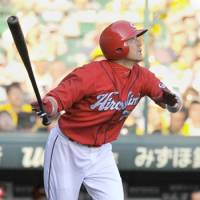 Key hit: Hiroshima's Takuro Ishii smacks a triple during his team's seventh-inning rally against Hanshin on Saturday at Koshien Stadium. The Carp defeated the Tigers 4-3. | KYODO PHOTO