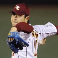 Aiming for the playoffs: Rakuten Eagles starter Hisashi Iwakuma delivers a pitch against the Softbank Hawks on Tuesday at Kleenex Stadium. | KYODO PHOTO