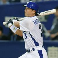 Never too old: The Dragons' Kazuyoshi Tatsunami, who turned 40 in August, smacks a two-run double in the fifth inning against the Swallows on Monday at Nagoya Dome. | KYODO PHOTO
