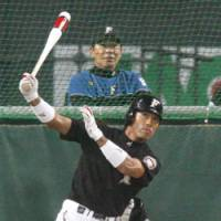 Eyes on the prize: Fighters outfielder Atsunori Inaba takes his cuts during batting practice on Tuesday at Sapporo Dome. | KYODO PHOTO