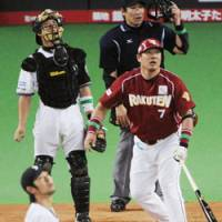 Not enough: Rakuten's Takeshi Yamasaki hits a bases-loaded double in the seventh inning off Fighters pitcher Shintaro Ejiri at Sapporo Dome on Wednesday. Nippon Ham came back to beat the Golden Eagles 9-8. | KYODO PHOTO
