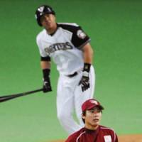 Nippon Ham's Terrmel Sledge hits a walkoff grand slam in the bottom of the ninth inning to stun pitcher Kazuo Fukumori and the Rakuten Golden Eagles at Sapporo Dome on Wednesday. The Fighters won 9-8.   KYODO PHOTO
