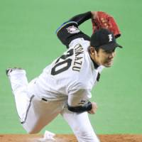 Fighters pitcher Keisaku Itokazu gives his club seven innings of one-run ball in a 3-1 victory over the Eagles in Game 2 of the PL Climax Series second stage on Thursday. | KYODO PHOTO