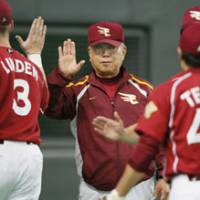 Another chance: Eagles manager Katsuya Nomura (center) congratulates his players after Tohoku Rakuten's 3-2 victory over the Fighters in Game 3 of the PL Climax Series second stage on Friday at Sapporo Dome. The Eagles staved off playoff elimination, forcing a Game 4 on Saturday. | KYODO PHOTO