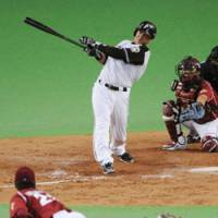 Power supply: Fighters slugger Terrmel Sledge crushes a three-run homer in the eighth inning off Eagles pitcher Hisashi Iwakuma in Game 4 of the Pacific League Climax Series second stage. Hokkaido Nippon Ham beat Tohoku Rakuten 9-4 and advanced to the Japan Series. | KYODO PHOTO