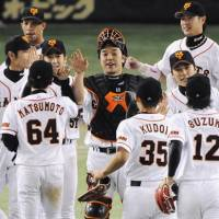 Thrill of victory: Yomiuri Giants players celebrate their series-ending victory over the Chunichi Dragons on Saturday. | KYODO PHOTO
