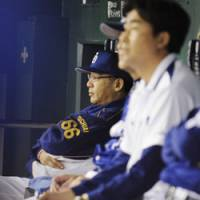 Disappointing finish: Dragons manager Hiromitsu Ochiai watches his club end its season with an 8-2 loss to the rival Giants in Game 4 of the Central League Climax Series second stage on Saturday at Tokyo Dome. | KYODO PHOTO