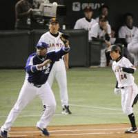 Big things come in small packages: Tetsuya Matsumoto (right) has played his way into a starting role with the Yomiuri Giants this season.   KYODO PHOTO