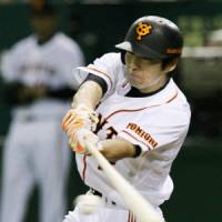 Memory lane: Michihiro Ogasawara won an MVP award with the Hokkaido Nippon Ham Fighters but will be leading the Yomiuri Giants in the Japan Series. | KYODO PHOTO
