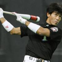 Ready to play: Fighters outfielder Atsunori Inaba works out during Friday's team practice at Sapporo Dome. The veteran will be participating in his fifth Japan Series starting on Saturday. | KYODO PHOTO