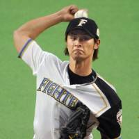 Secret weapon: Hokkaido Nippon Ham's Yu Darvish unloads on the Yomiuri Giants in Game 2 of the Japan Series on Sunday. The Fighters won 4-2 to level the series. | KYODO PHOTO