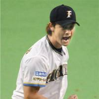 Rock star: Yu Darvish's dashing good looks have attracted a new wave of fans to Hokkaido Nippon Ham's games. | KYODO PHOTO
