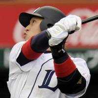 Power display: The Lions' Hiroyuki Nakajima hits a game-tying homer in the seventh inning against the Marines on Saturday at Seibu Dome. Saitama Seibu defeated Chiba Lotte 2-1 on Opening Day. | KYODO PHOTO