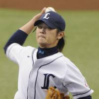 Strong start: Seibu ace Hideaki Wakui, the reigning Sawamura Award winner, allows one run and strikes out 10 batters in 7 2/3 innings, giving his club a big boost in its first game of the season.   KYODO PHOTO