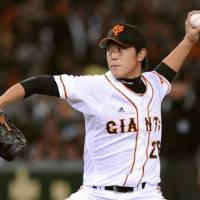 Winning form: Giants southpaw Tetsuya Utsumi fans 10 batters and holds the Swallows to four hits over eight innings on Friday at Tokyo Dome. Yomiuri beat Tokyo Yakult 4-1.   KYODO PHOTOS