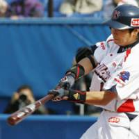 Pitcher's nightmare: Swallows star Norichika Aoki slugs a three-run home run in the first inning against the BayStars on Saturday at Jingu Stadium. Aoki also belted a solo homer in Tokyo Yakult's 13-12 victory over Yokohama.   KYODO PHOTO