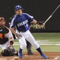 Hirokazu Ibata of the Dragons connects for an RBI double during the second inning of Friday's game against the Yomiuri Giants at Tokyo Dome. Chunichi won 7-4.   KYODO PHOTO
