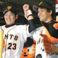 Double team: Ryota Wakiya (left) and Shugo Fujii enjoy their moment in the spotlight after helping the Giants beat the Swallows on Monday night. | KYODO PHOTO