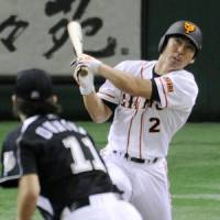 Off the leash: Michihiro Ogasawara hits a solo homer during the Giants' 10-8 win over the Marines on Sunday. | KYODO PHOTO