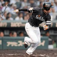 Jack of all trades: Softbank pitcher Toshiya Sugiuchi hits an RBI single against the Tigers on Monday. | KYODO PHOTO