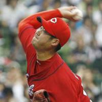 Winning form: Carp hurler Kan Otake earns his first victory since October 2009 on Saturday. Hiroshima beat Seibu 6-2. | KYODO PHOTO