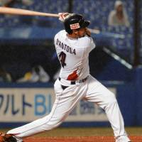 Jamie D'Antona of the Swallows belts a two-run homer in the fourth inning of Monday's game against the Hokkaido Nippon Ham Fighters at Jingu Stadium. Tokyo Yakult won 6-0. | KYODO PHOTO