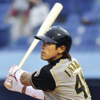 Super day: Fighters outfielder Atsunori Inaba bashes a first-inning home run against the Swallows on Tuesday at Jingu Stadium. Inaba added a solo shot in the third inning of Hokkaido Nippon Ham's 10-2 win. | KYODO PHOTO
