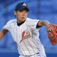 In the spotlight: Japan hurler Yuki Saito pitches against South Korea in the opening round of the World University Baseball Championship on Friday at Jingu Stadium. Japan won 4-0. | KYODO PHOTOS