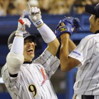 Great start: Teammates congratulate Japan's Hayata Ito after he hit a two-run home run in the sixth inning.