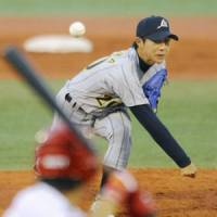 No mercy: Japan hurler Yusuke Nomura fires a pitch against China on Saturday night in the World University Baseball Championship. Japan won 15-0 in a game stopped after six innings due to the mercy rule. | KYODO PHOTO