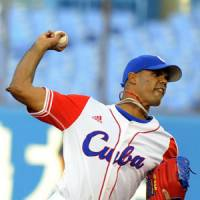 Big honor: Cuba right-hander Miguel Gonzalez fires a pitch against the United States in the 5th World University Baseball Championship's title game on Saturday at Jingu Stadium. | KYODO PHTO