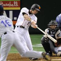 Bashing it: The Giants' Michihiro Ogasawara belts a solo home run off BayStars starter Shigeru Kaga in the fifth inning at Tokyo Dome on Friday. Yomiuri beat Yokohama 8-6. | KYODO PHOTO