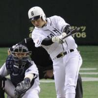 Coming of age: Hisayoshi Chono hits a single during the Giants' 6-4 win over the Dragons on Tuesday. | KYODO PHOTO