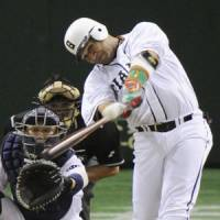 Fan favorite: Giants slugger Alex Ramirez clubs a two-run homer in the seventh inning on Thursday against the Dragons at Tokyo Dome. Yomiuri defeated Chunichi 10-4. | KYODO PHOTO