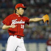 Hot touch: Kenta Maeda threw a complete game against the Swallows on Thursday. | KYODO PHOTO