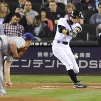 The hits keep coming: Ichiro Suzuki hits a single during the first inning of the Mariners' game against the Rangers on Saturday. The hit was the 3,500th of his career.   KYODO PHOTO